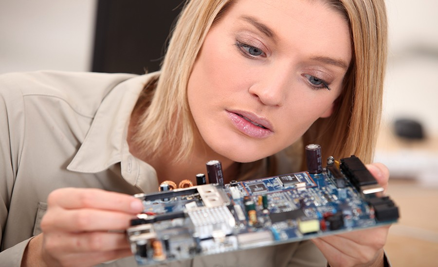bigstock-woman-repairing-pc-22876868
